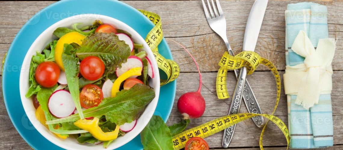 fresh-healthy-salad-and-measuring-tape-healthy-food-photo-1